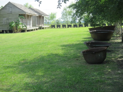 slave quarters, left. Sugar boiling kettles, right